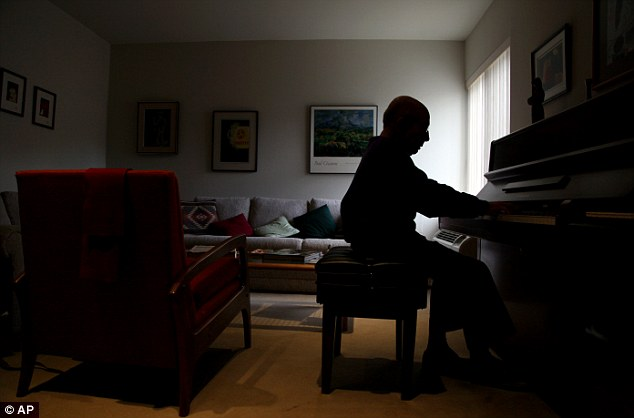 Memories: Dr George Horner performs a song on the piano at his home in Newtown Square, Philadelphia