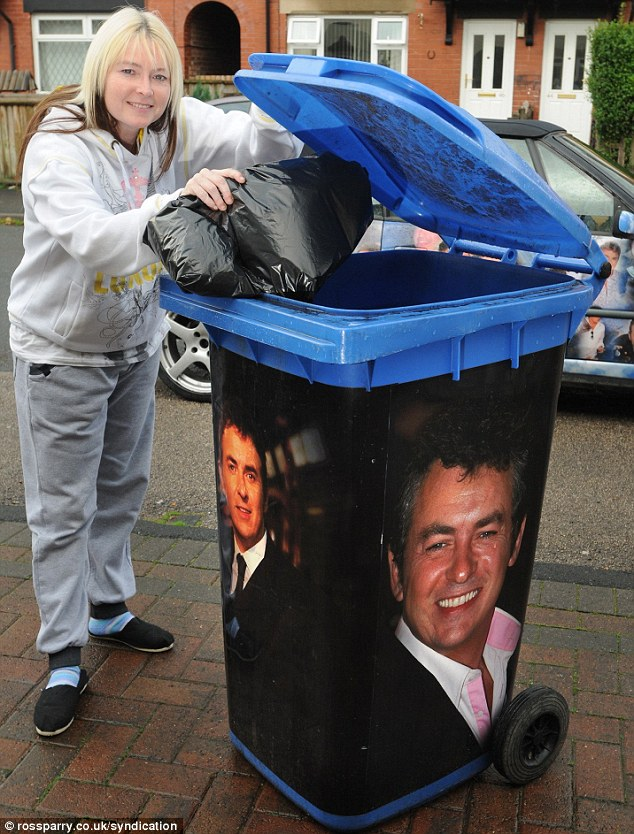 Mandy paid £1,000 to have pictures of Shane plastered on her car. She also decorated her wheelie bin