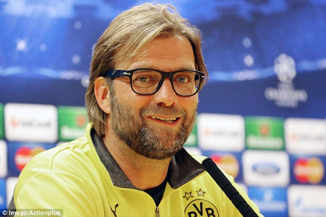Generous: Jurgen Klopp, who has a touchline ban, was full of compliments for Arsenal... but don't take him lightly