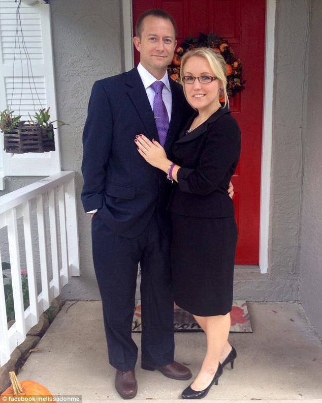 Found love: Melissa Dohme with her boyfriend Cameron Hill last year - who was one of the paramedics who responded to her 911 call when she was stabbed 32 times in the face and neck