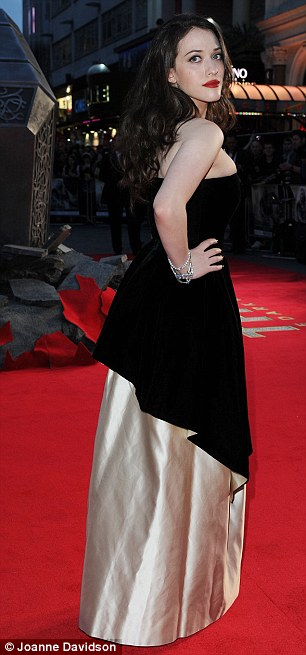 Eye-catching: Kat Dennings turned heads in a dramatic dress which showed off her cleavage