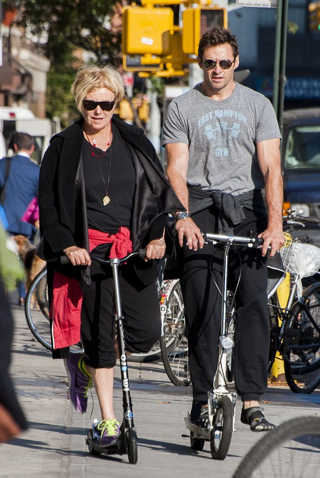Unsteady: Hugh Jackman's wife Deborra-Lee Furness edges in front as they while out exercising in New York