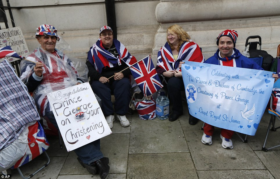 Royal supporters: Well-wishers (left to right) Terry Hutt, Julie Cain, Marie Scott and John Loughrey brave the bad weather as they set up camp up outside the Chapel Royal, St James's Palace in London ahead of the christening of Prince George