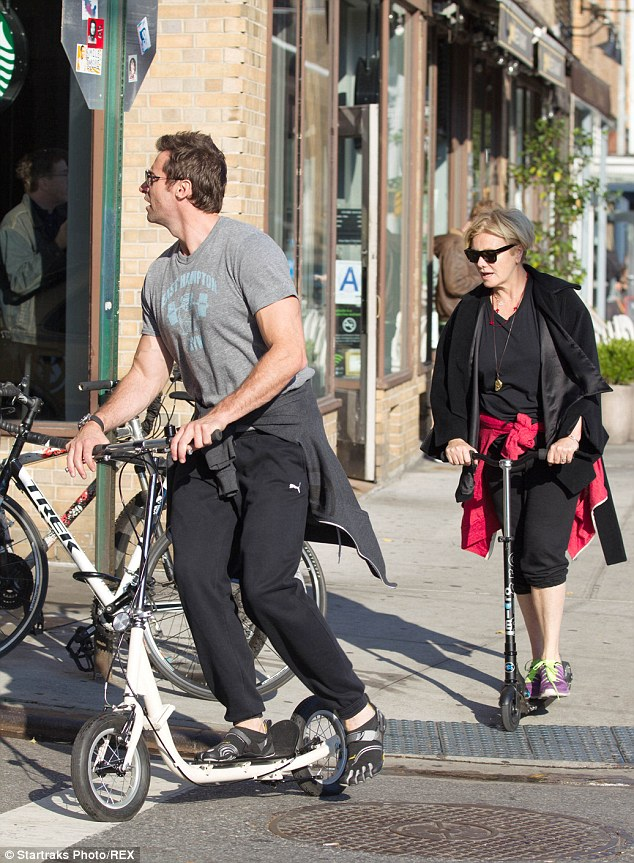 Leading man: Hugh and Deborra chatted happily together while exercising on their scooters