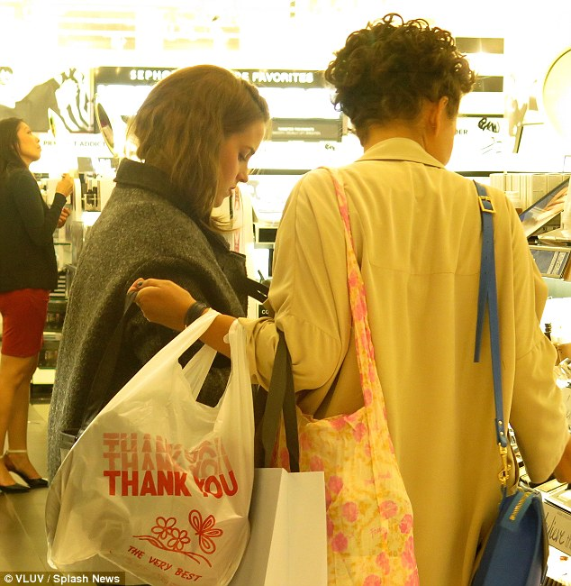 Mere mortal: Emma Watson does some evening shopping with a friend at Sephora in Century City