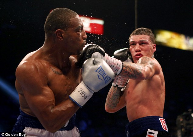Exchange: J'Leon Love (left) is on the wrong end of a Gabriel Rosado jab in their Las Vegas fight in May