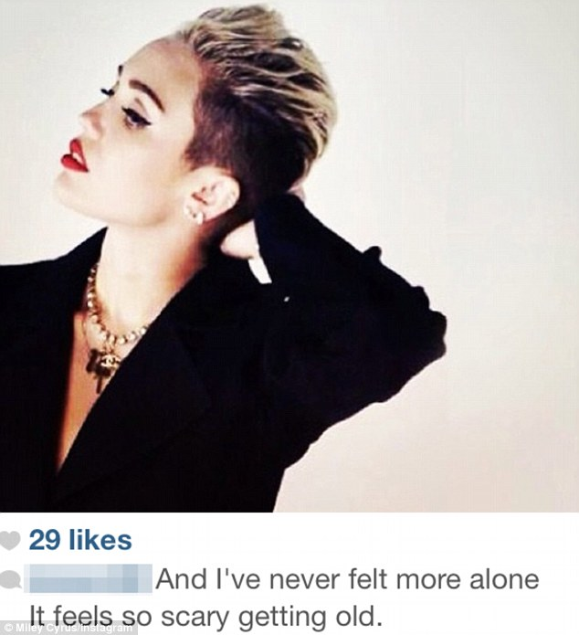 Forlorn: Downcast Miley Cyrus posted a photograph to Instagram of herself on Tuesday with a very forlorn accompanying caption