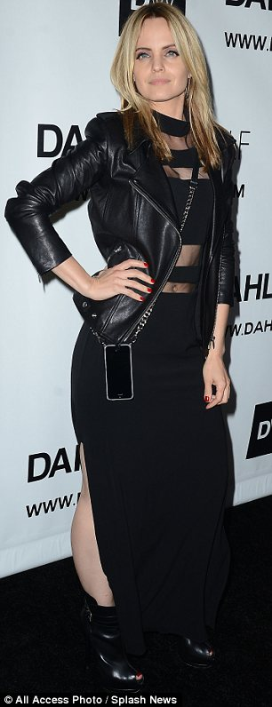 Showing some skin: Mena Suvari wore a black dress with sexy sheer panels and a split up one side
