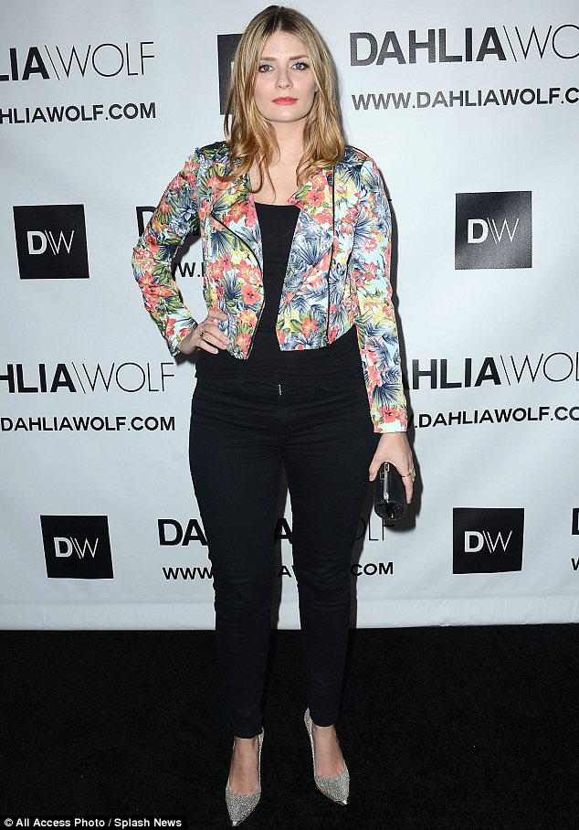 Floral fancy: The actress teamed a black tank top and jeans with a statement flowery jacket and sparkly shoes
