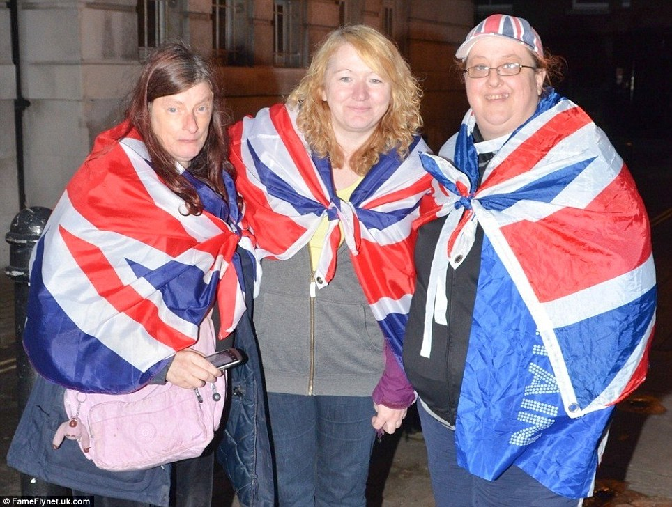 Braving the wind and rain: Royal fans wait outside the chapel of St James overnight, ready for the christening of Prince George and hopefully a glimpse of the future king