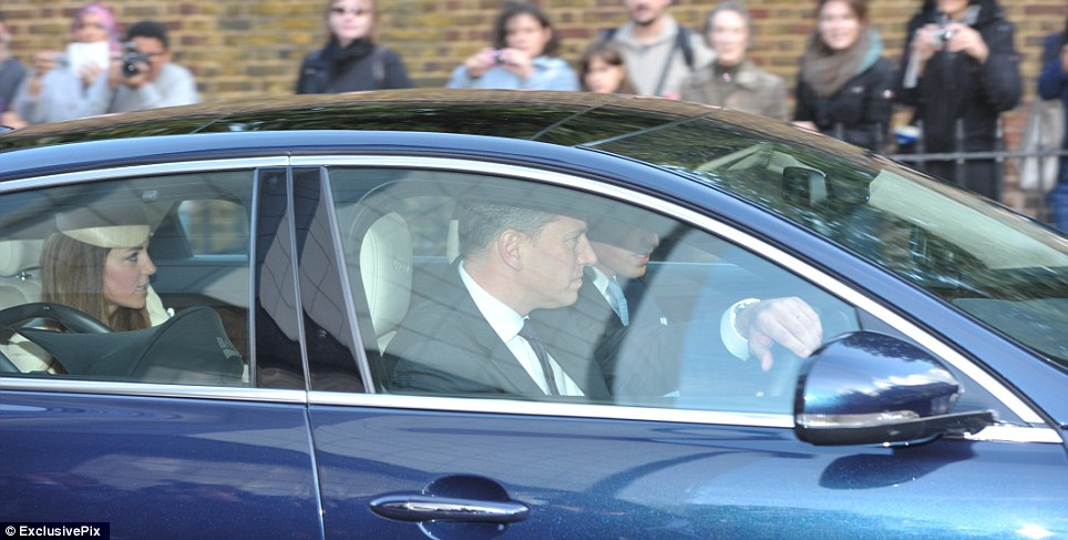 Prince George's day: The Duke and Duchess of Cambridge and future king Prince George in his car seat head off to the christening yesterday afternoon