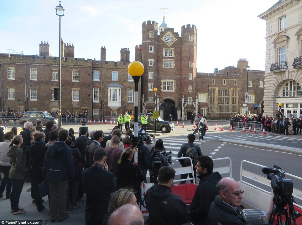 Huge amount of interest: Spectators stood five or six seep outside the historic St James's Palace as the royal family were inside