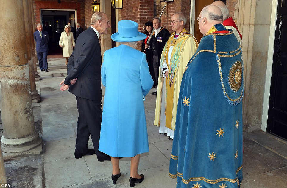 Royal thanks: Her Majesty and her husband Prince Philip speak to the senior clergyman as they arrived for the christening