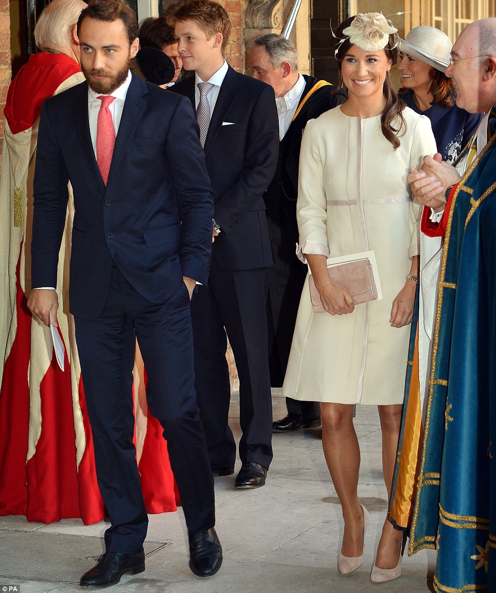 Siblings: Pippa and James Middleton walk out of the chapel with the small congregation, including their smiling mother Carole yesterday afternoon