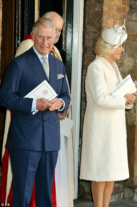 The Prince of Wales and Duchess of Cornwall leave the Chapel Royal in St James's Palace, central London, following the christening of Prince George