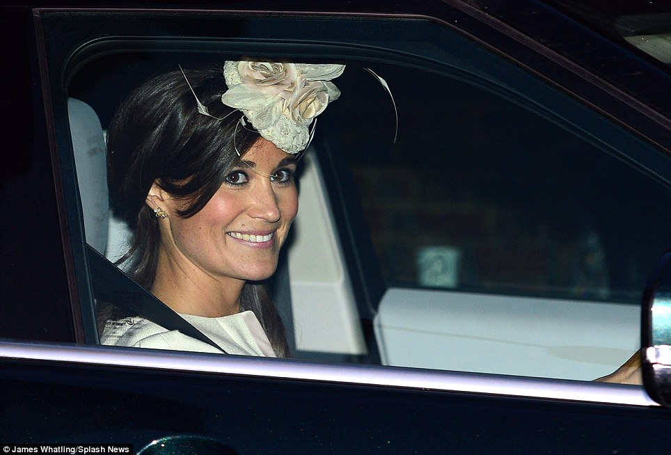 Still smiling: Kate's sister Pippa Middleton leaves Kensington Palace after the christening of Prince George at the Chapel Royal in St James' Palace