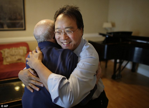 Embraced: Yo-Yo Ma greets George Horner in a rehearsal room before their performance