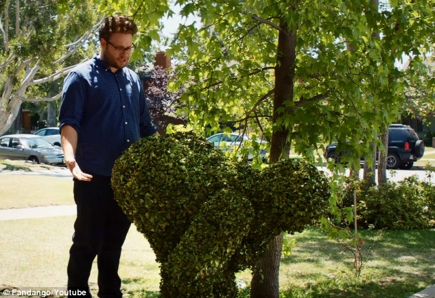 Pushed over the hedge: Seth Rogen's Mac is less than pleased after the frat-boys trims his bush into a woman bending over