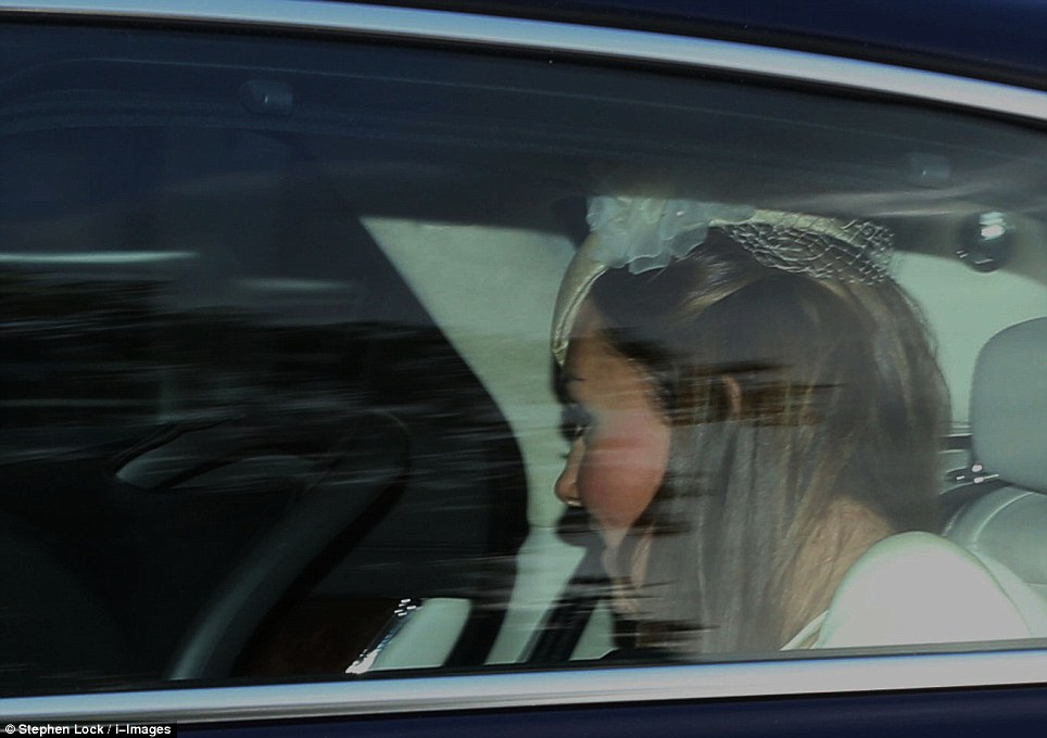 The Duchess of Cambridge was seen to lean over and talk to little Prince George as they arrived at the palace ahead of his 3pm christening yesterday