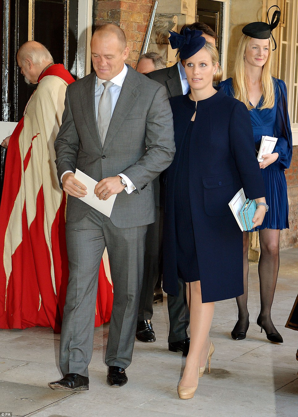 Prince George's godmother Zara Tindall, seen here with rugby-playing husband Mike, was chic in navy at the royal christening - behind her is William van Cutsem's wife, Rosie