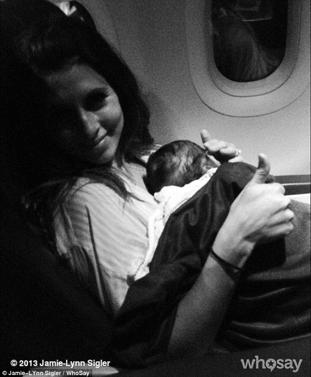 All smiles! Jamie-Lynn tweeted a picture of herself and a sleeping baby Beau aboard a plane on Wednesday morning