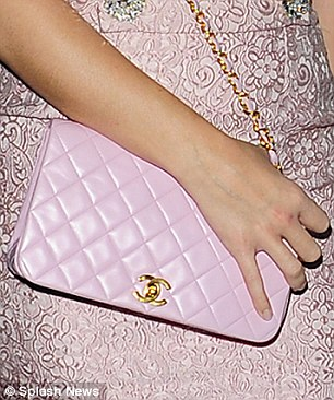 She chose pink: A purse from her top label