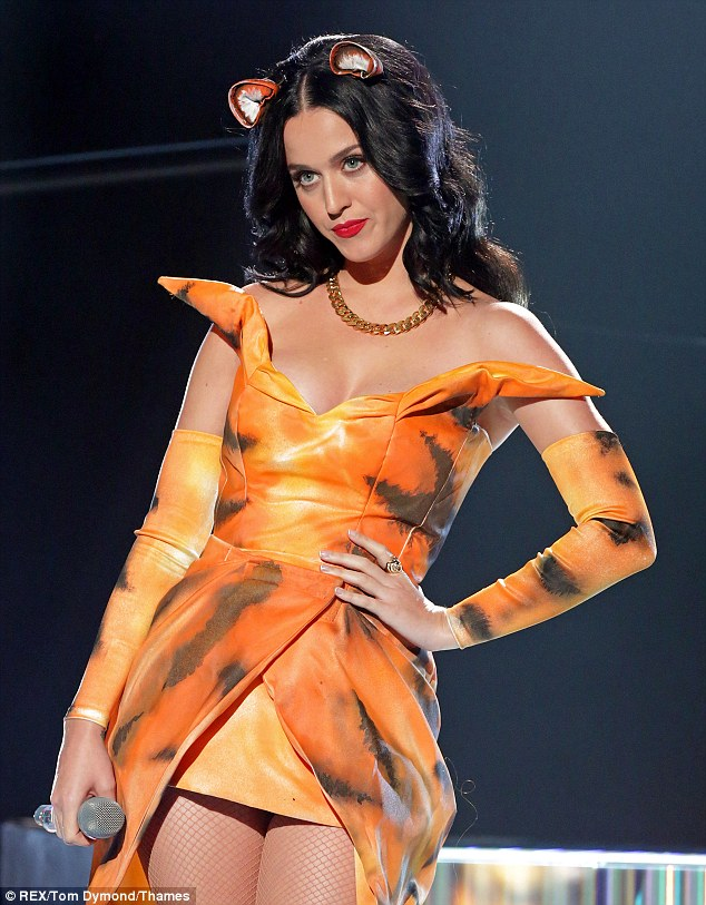 Cute and quirky: In a new interview with UsWeekly, Katy Perry - seen here on Sunday - reveals all kinds of things, like that she believes in aliens and has a ticket to outer space