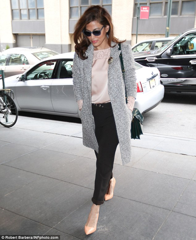 Top form! Eva Mendes, 39, looked chic in a pink and silver outfit as she arrived at a business meeting in New York on Wednesday