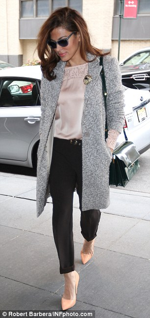 Fashionista: The Hitch actress dressed perfectly for the autumn morning, teaming soft pinks and silver-greys with a pair of sleek black trousers