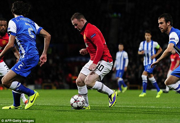 On the run: Wayne Rooney took just 60 seconds to carve open to Sociedad defence in the build-up to United's opener