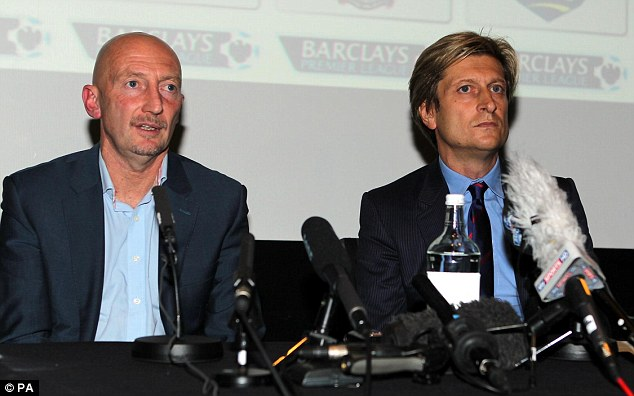 Gone: Parish (right) sits beside Ian Holloway at a press conference on Wednesday to announce his departure