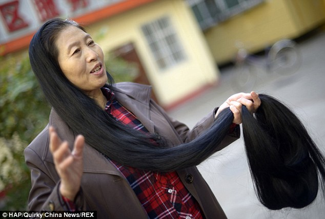 Lengthy: Ni Linmei, of Shanxi province, China, spends two hours every day to wash and dry her jet black hair