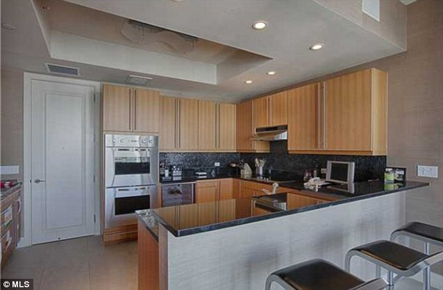 Cool kitchen: The condo features a roomy kitchen with Poggenpohl cabinets