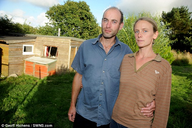 Eco-home: Daniel and Lora Newman have been forced to tear down their five metre by six metre cabin in Carharrack, Cornwall, because it was built without planning permission