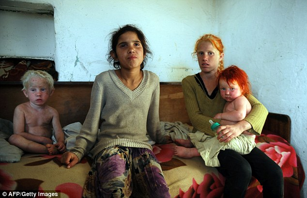 Four of the children of Sasha Ruseva and Atanas Rusev pictured today at their home in the Roma district of the central Bulgarian town of Nikolaevo