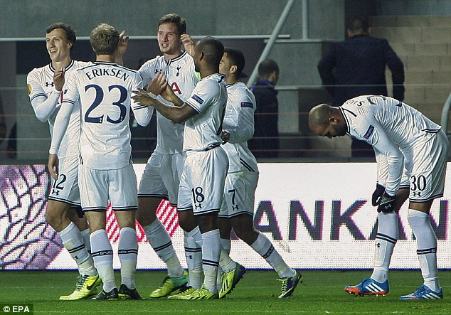 All smiles: Vertonghen is mobbed by his Spurs team-mates after scoring