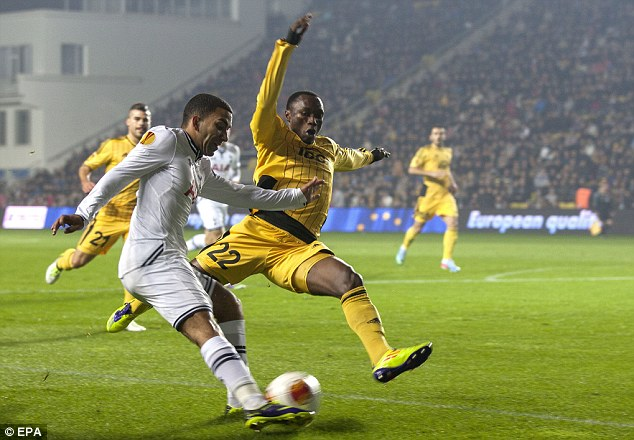 On the attack: Aaron Lennon attempts a cross as Djibril Paye slides in to block