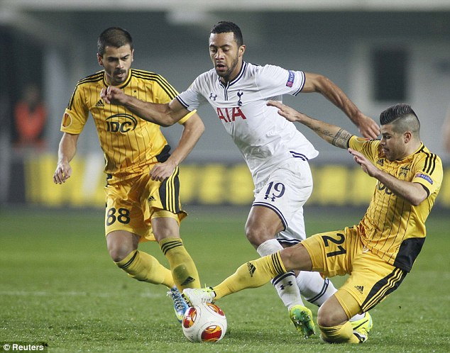 No way through: Marko Stanojevic slides in to steal the ball from Mousa Dembele