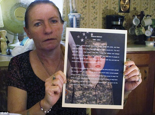 Lori Ballman holds a tribute to her late daughter, Deanna, at her home in Pataskala, Ohio, in May 2013