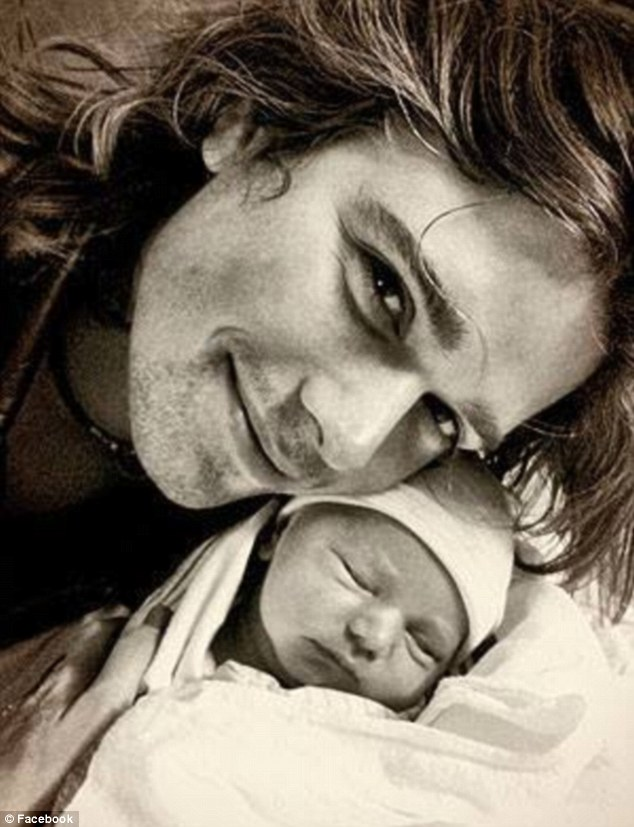 'Very excited!' Zac Hanson shared a snap of himself with his son George, who was born on October 17