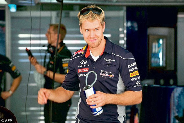 All set: Red Bull driver Sebastian Vettel inspects the pit at The Buddh International circuit