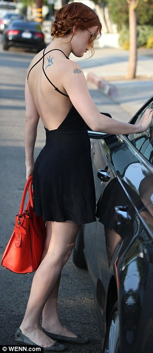 Less isn't always more: The 25-year-old obviously wasn't wearing a bra under her backless frock, which showed off the tattoos on her shoulder