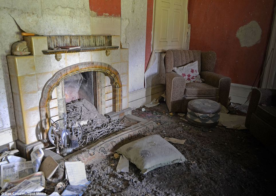 Dust: The years of dereliction are betrayed by the living room which has a thick layer of dust on the floor