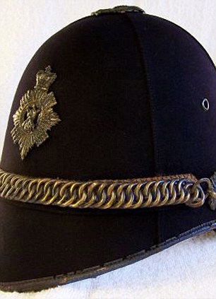 Chain gang: The chain-link decoration on the grey flannel Sovereign Dress (L) harks back to detailing on a 1910 royal constabulary helmet (R)