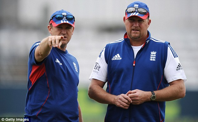 Pointing the way forward: David Saker (right, with coach Andy Flower) will remain with England until 2015