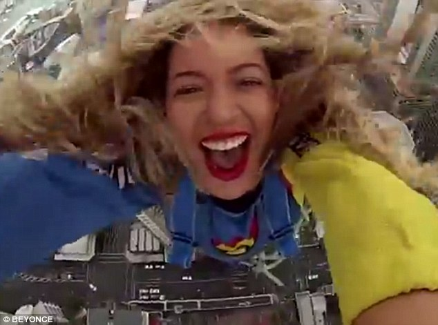 Freefalling: Beyonce takes a selfie as she howls with laughter during her 1,000ft plunge from the top of the Sky Tower in Auckland, New Zealand