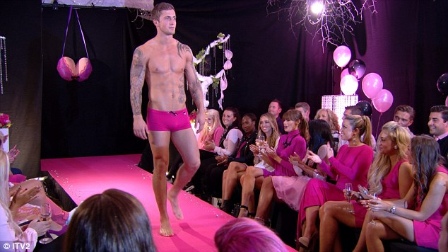 Pink never looked so good: Dan Osbourne showed off his model credentials as he strutted his stuff
