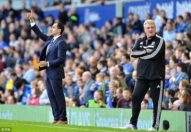 New gaffer: Huddlestone is delighted with how Hull are progressing under manager Steve Bruce (right)