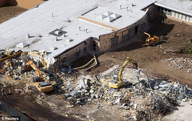 Relief: Demolition of Sandy Hook Elementary school in Newtown, Connecticut, began on Friday. The school was the scene of a deadly massacre in December 2012