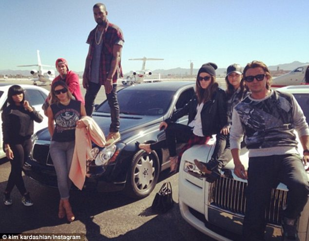 The krew: Kim Kardashian shared this photo on Instagram after landing in Las Vegas with Kanye West and friends, including Tyga (second from left) and Jonathan Cheban (far right) on Friday